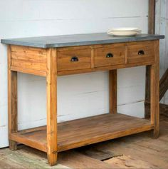 "Sturdy wooden workstation with three drawers and a zinc top. 54"" x 26 ½"" x 38 ½"""