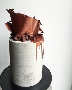Would you have concrete on your wedding cake? . . #concretecake #skyscraper #copper #concrete #chocolatesails #architecture #weddingcake #industrialwedding #sharpedges #donttellcharles