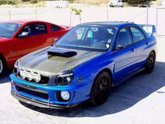 Off-road ready Subaru Impreza WRX bugeye with carbon fiber STi-style hood and rally lights
