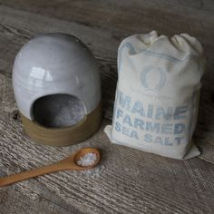 Salt Cellar Gift Set. This wooden gift box from Farmhouse Pottery contains a salt cellar with wooden spoon, along with a supply of sea salt freshly harvested from the coast of Maine. From $81 at slowlivingshop.com.
