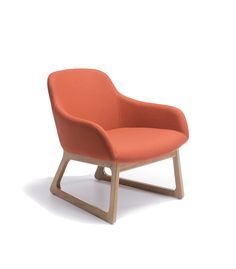 Upholstered lounge chairs with solid oak leg frames in natural or walnut.