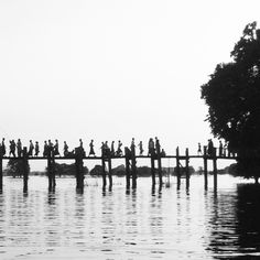U Bein Bridge in Myanmar  This is the longest wooden footbridge in the world built by salvaging the unwanted teak columns from the old palace during the move to Mandalay. >>> Love this photo and would love to go here