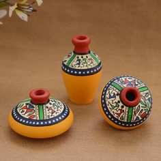 This pot is made of terracotta, brought to you from Uttar Pradesh and decorated with the Warli art, native to the tribals of Maharashtra. Shop Unravel India Terracotta Yellow Warli handpainted Decorative Pot(Set of online. Worli Painting, Bottle Painting, Ceramic Painting, Bottle Art, Bottle Crafts, Poetry Painting, Painting Studio, Pottery Painting Designs, Pottery Designs