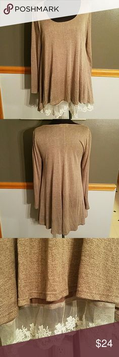 "Umgee Oversized Top w/ Lace Bottom Detail Worn once Umgee oversized lighter weight top with cute lace bottom detail. Sleeves are approximately 24"". Shoulder to bottom measures approximately 30"". See photo for better color. Umgee Tops"