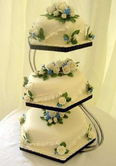 Ivory cakes | This three-tier Hexagonal fruit cake was decorated ...