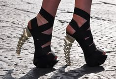 A fashionable, sexy, high heel shoe for you ladies w/ spine probs