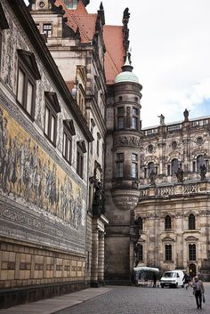 Dresden Parade of Nobles, Germany. The mural of ceramic tiles on the wall at the left traces the reign of the nobles who ruled this part of Germany from the 12th Century.