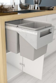 """It's not always possible to hav a fixed drawer style front on a pull out kitchen bin – for example when retrofitting into an existing cupboard. Many Tanova Simplex kitchen bins models have a """"handle"""" style model that is mounted behind a hinged door. Kitchen Cabinet Door Styles, Cupboard Doors, Kitchen Cupboards, Kitchen Bins, Kitchen Decor, Cupboard Ideas, Diy Kitchen Storage, Kitchen Organization, Kitchen Containers"""