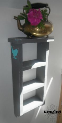 Grey Distressed Hanging Shelf with Turquoise Bird Accent. $35.00, via Etsy.