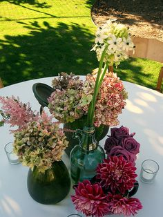Wildflower Wedding Centerpieces like this idea of a few different size jars. Could sit on lace dollies