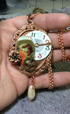 One of my pieces for the Build a line challenge, B'sue bezel in back, bird heart, watch face and vintage drop pearl.  There is a small flower that the bird is ready to check out!