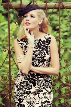 Add some Italian charme to your wardrobe with this 60s Bardot Yoko Dress!You'll feel super feminine and elegant when wearing this beautiful dress; from the boat neck, low cut back to the classy fitted style.Made from a supple and stretchy, cream coloured, structured fabric featuring an amazing black floral print that's comfy to wear and doesn't mark any problem areas.This classy beauty takes you back to classy Italy in the 1960s, ciao bella!   Fitted...