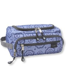 Carryall Toiletry Kit, Print | Free Shipping at L.L.Bean - I've used this little guy to store our toiletries (which I consider shampoo/conditioner/sunscreen/etc) and as a makeup bag. It works excellent for both purposes and keeps the rest of your items dry, even if the contents inside are still damp from the shower.