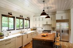 Butcher Block with barnwood sides.  Note sloped soffit space = illusion of height.  Grey and Scout | Interior Inspiration: PORTLAND