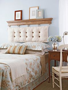 Headboard made by hanging an old bench cushion. Better secure it really well... wouldn't want that shelf falling down!!