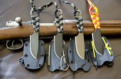"""Four Ardent Knives """"Shrike SE"""". OD Green, Graphite Black, Burnt Bronze and Graphite Black Cerakote coated blades. 550 cord wrapped handles. www.ardentknives.com  100% hand made in the USA"""