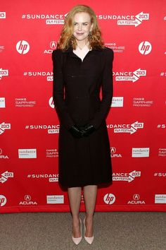 Nicole Kidman looks ever so chic in a slim-fit black coat and cream-coloured heels, proving sometimes simplicity will DO just the trick.