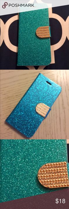 💠TURQUOISE IPHONE 6, 6S APPLE COMPATIBLE CASE💠 TURQUOISE IPHONE 6, 6S CASE WITH DRIVERS LICENSE AND CREDIT CARD SLOTS!                       Fitted Case / Skin / Cover Shell which closes with magnetized tab!  Compatible Brand: Apple IPhone 6, IPhone 6S Material: Synthetic, Dirt Resistant                                                          Inside Color: Turquoise, Gold & Crystal Tab            Outside Color: Suede, Gold Design/Finish: Sparkly Cover Features: Card Holder, Kickstand…