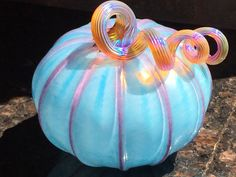 Hand-blown glass pumpkin by the Hansens in 2006 or 2007, from the BAGI glass pumpkin patch in Palo Alto, CA.