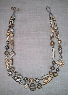 These are old pumtek beads from Mizoram, made in Burma about 100 years ago, strung as a modern necklace, in a private collection.