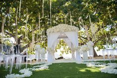 Kauai Wedding: A bride and groom flew from Mongolia for their wedding at the St. Regis Princeville hotel in Kauai, Hawaii, where Belle Destination Events hung strands of white flowers from trees.