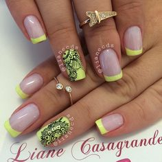 Yellow and black French tip nail designs. Gives your French tips a twist by adding elaborate lace designs in black nail polish.