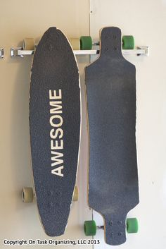 Use a towel bar on a garage wall to store long boards.