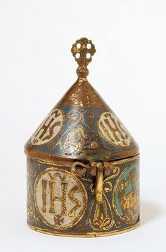 A thirteenth-century French champlevé enamel on copper pyx decorated with the 'sacred monogram': the letters 'IHS', the first letters of 'Jesus' in Greek. (Victoria & Albert Museum)