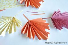 paper leaf wreath | The Folded Paper Fall Leaves look beautiful displayed as a garland .