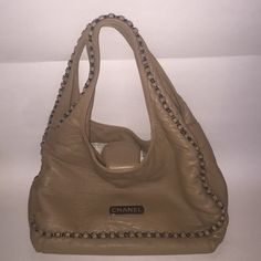 "Authentic Chanel hobo bag . Chain link trim Perfect condition. Deep beige hobo bag. LAMBSKIN leather. Deep Silvertone chain link trim. Zipper pocket on inside. 2 large slip I let's and snap closure across the top. CHANEL logo plate in front. If you need more pics just ask! I will create another listing. Price is firm . 17 1/2"" from top of handle to bottom of the bag! 14"" wide 6"" deep. Strap drop is almost 9"" CHANEL Bags Hobos"