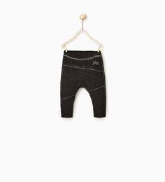 Spodnie z przeszyciami
