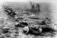 British dead awaiting burial on the Somme by what looks to be a German burial party