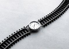 watch and train tracks - Creative Photographic Compositions by Chema Madoz  Jose Maria Rodriguez Madoz, aka Chema Madoz, is a Spanish photographer best known for his eye-catching illusions and surrealist photos.