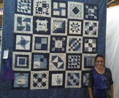 Amber Cole (age 11) with her Grand Champion Quilt entered in the Roseau County Fair in 2013.  She started this quilt when she was only 8. The fabric and blocks are from a  MN Shop Hop.. Amber  worked diligently to complete the quilt for 3 years.  The quilt was entered  in the open class exhibition at the fair.  When the judges found out how young the quilter was, they were amazed.  Amber's Mom & Grandmother own Northern Exposure Quilt Shop, where she learned to sew.