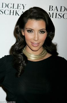 At a Badgley Mischka fashion show in New York in 2009 Kim went for all out glamour with generous curls