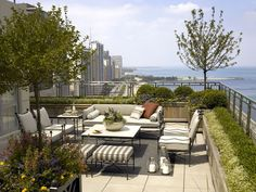Residential - Scott Byron & Co. - Urban rooftop garden located in the historic Palmolive Building offers an intimate entertaining terrace while framing and enhancing dramatic vistas of the city and lake. Photography by Tony Soluri