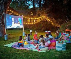 Pass the popcorn! Learn how to host a blockbuster backyard bash, complete with movie trivia, popcorn bar, and a Hollywood-sized screen. outdoor fun Summer Movie Night in Your Backyard Backyard Movie Nights, Outdoor Movie Nights, Summer Parties, Summer Fun, Summer Nights, Camping Parties, Summer Ideas, Summer Camps, Adult Camping Party
