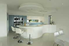 Modern curved kitchen from Bradburys of Exeter.