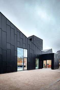 A sawtooth roof with integrated skylights and solar panels gives this library and cultural centre in Denmark an industrial aesthetic that references its location at an old furniture factory Black Architecture, Factory Architecture, Contemporary Architecture, Architecture Details, Minimalist Architecture, Metal Cladding, Exterior Cladding, Building Facade, Building Design