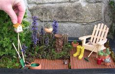 A 6 year old Miniature Garden with a Tompa Dwarf Spruce (Picea abies 'Tompa'), Carpet Bugleweed with the purple flowers (Ajuga) and White Thyme (Thymus serpyllum 'Alba')