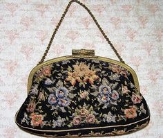Vintage Art Deco Czech floral petite point purse Decorative etched gold tone frame Black background with multi color flowers I see no damage to the fabric Pink grosgrain lining is in good vintage condition, there are make up marks, original mirror in pocket Perfect for a vintage