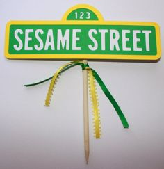 put up a Sesame street sign by sesame street books.