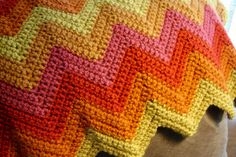 The zig-zag crochet style could easily be adapted into a very trendy chevron throw.