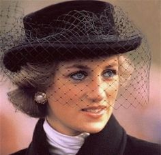 her early style included hats with netting, I even had one and loved to wear it