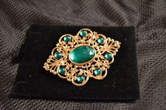 Green and gold pendent