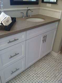 Floor would look good with dark cabinet and white top with penny tile backsplash