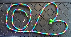 Earbuds Strung with Perler Beads!! Never untangle your earbuds again!! Using an Exacto knife, cut a slit in bead and open at slit to slip onto cord. Time consuming but super easy.