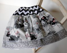 """Sewn with """"a ghastlie night"""" and """"a ghastlie crewel"""" fabrics for skirts attached to Riley Blake's black and white chevron print in this cute children's skirt. Rolled hemmed edges. Perfect for fall and Halloween. Size 2T."""