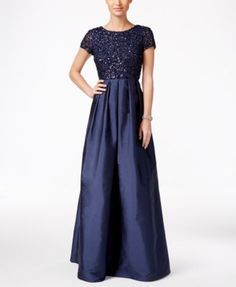 Adrianna Papell Beaded Scoop-Back A-Line Gown $329.00 The gorgeous sheen of a floor-length skirt is matched by a sequined bodice on this classic cap-sleeve gown with shoulder-baring back from Adrianna Papell.