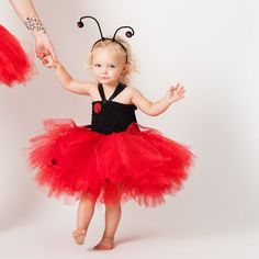 My ladybug tutu for girls features a stretchable and front-lined tutu top which has hand sewn ladybug on the front. The tutu dress has a halter
